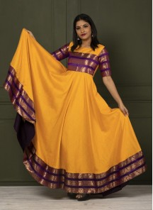 Beautiful Yellow Colored Festive Wear Woven Tapetta Silk Gown