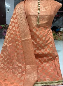 Bedazzling Banarasi Jacquard Peach weaving Work Dress Material