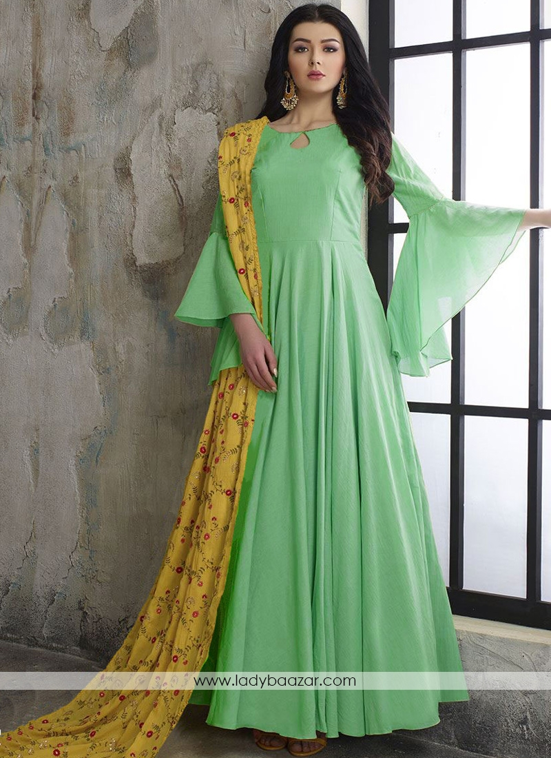 Demure pastel green designer wear long dress With Embroidered Dupatta