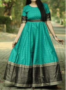 Graceful Rama Green Colored Festive Wear Woven Tapetta Silk Gown