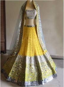 Magnetize Yellow Patch Border Work Net A Line Lehenga Choli