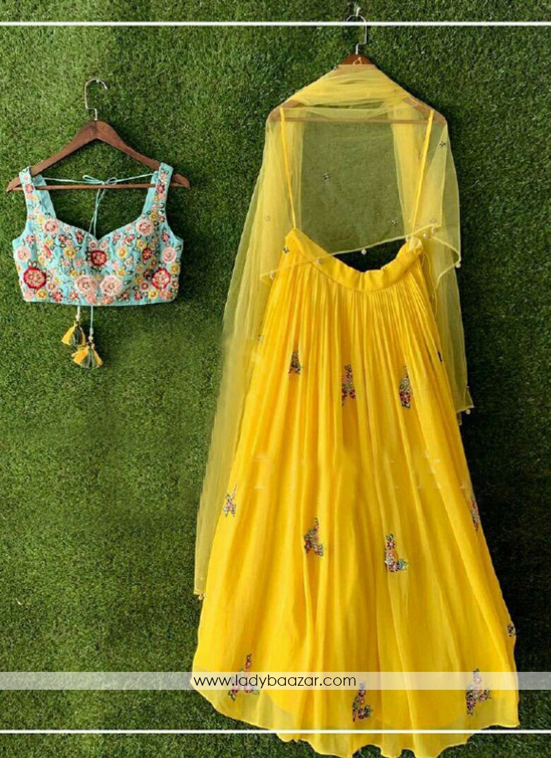 Miraculous Embroidered Georgette Yellow Party Wear Lehenga Choli