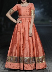 Staring Orange - Peach Colored Festive Wear Woven Tapetta Silk Gown