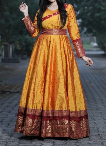 Unique Musturd Yellow Colored Festive Wear Woven Tapetta Silk Gown